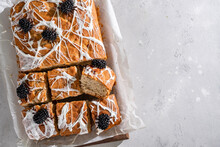 Halloween Decorated Food. Banana Bread Cake Bars With Halloween Marshmallow Web And Funny Blackberry Spiders