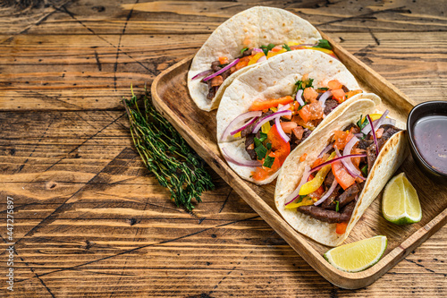 Tela Tacos with beef meat, onion, tomato, sweet pepper and salsa