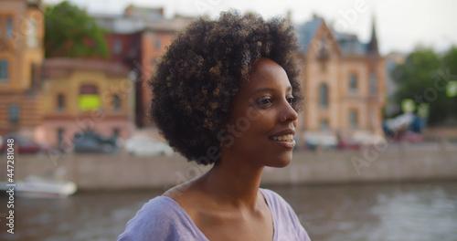 Close up portrait of beautiful african standing on city street Tapéta, Fotótapéta
