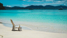 Lonely Beach Chair With Cloudy Blue Sky And Sun At Coral Island, Phuket, Thailand