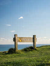 A Warning Sign On A Clifftop In The South Downs, England.