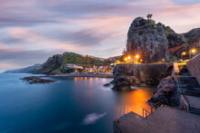 Dusk Lights Over The Seaside Town Resort Of Ponta Do Sol Washed By The Ocean, Madeira Island, Portugal, Atlantic