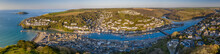Aerial Panoramic View Of The Beautiful Cornish Fishing Town Of Looe On A Sunny Spring Morning, Looe, Cornwall, England
