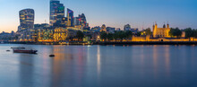 View Of The Tower Of London, River Thames And City Of London At Dusk, London, England
