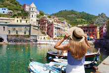 Holidays In Italy. Beautiful Female Tourist In The Picturesque Colorful Village Of Vernazza, Italy.