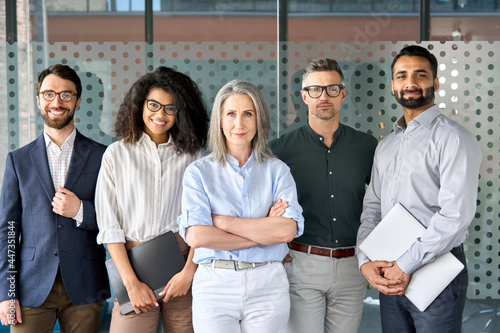 Fototapeta Happy diverse business people team standing together in office, group portrait