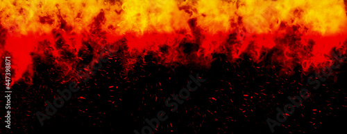 Fotografie, Obraz Abstract image of Orange fire or flames with sparkles and smoke in black background