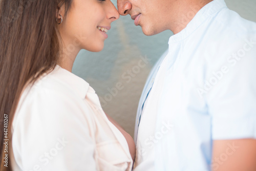 Fotografie, Obraz Mixed race couple close touching nose each other - love and relationship concept