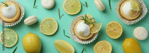 Fotografía Lemon cupcakes, macaroons and ingredients on mint background