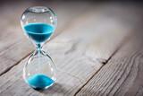 Fototapeta Big Ben - Hourglass background concept for deadline, urgency and countdown