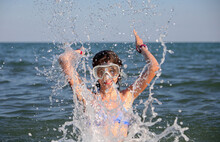 Little Girl With Diving Mask Plays The Stinking Water In The Summer In The Middle Of The Sea Having A Great Time