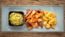 Nam Prik Num, Thai Food, Northern Thai Green Chilli Dip With Fried Pork And Crispy Pork Crackling In Rectangular Ceramic Plate On Rustic Natural Wood Texture Background, Top View