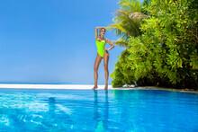 Beautiful Sexy Tanned Woman Bikini Model In Pool On Maldives Island. Young Glamour Girl In Swimsuit In Pool. Perfect Body Bikini Model In Luxury Resort On Maldives. Bikini Fashion. Luxury Travel.