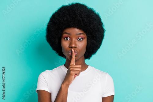 Fototapeta Photo of impressed short hairdo brunette young lady finger mouth wear white t-sh