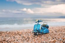 Vintage Miniature Blue Motorcycle On Summer Background.