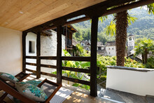 Bright Patio With Wooden Ceiling And Railing. Two Comfortable Rocking Chairs To Enjoy The Swiss Mountain Landscape