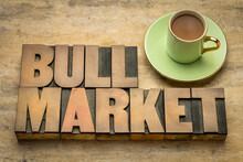 Bull Market Word Abstract In Letterpress Wood Type With A Cup Of Coffee, Market That Is On The Rise And Where The Conditions Of The Economy Are Generally Favorable