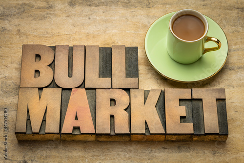 Fotografia, Obraz bull market word abstract in letterpress wood type with a cup of coffee, market