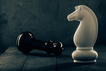 Two Chess Pieces On A Gray Non-uniform Background