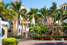 Bonita Springs, Florida Town In Collier County With Entrance To Famous Barefoot Beach With Street Road Through Neighborhood Luxury Houses