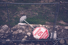 No Trespassing Sign Turned Over Behind A Fence