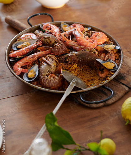 Delicious seafood paella in pan on rustic table
