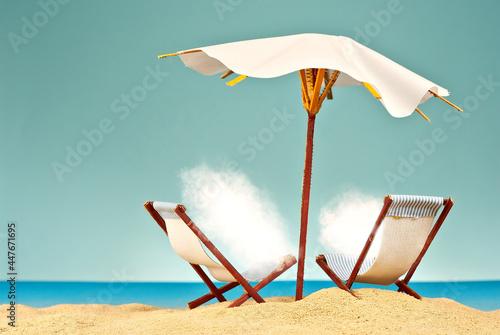 Fotografia Beach umbrellas and sunbeds on the sand