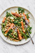 Salad With Millet Kale Roasted Carrots Avocado Beans And Chickpeas