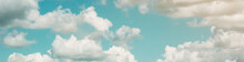 Background Of A Blue Sky With Large White Clouds. Summer Atmospheric Background. Warm Saturated Colors. Banner