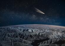 Comet Passing Over Desert Badlands, California, USA
