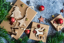 Overhead View Of Wooden Christmas Decorations And Gift Boxes