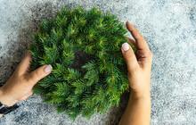 Overhead View Of A Woman Holding A Fir Wreath
