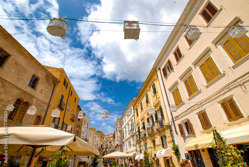 Fotografiet Summer view 2021 of the Alghero old town quarter and its narrow streets and the