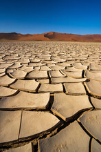 Cracked Mud Pan In Namib-Naukluft National Park, A Popular Travel Destination In Namibia, Africa.