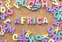 Color Alphabet In Word Africa With Another Letter As Frame On Cork Board Background