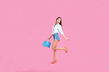 Happy Girl Holding A Shopping Bag On A Pink Background,Online Shopping