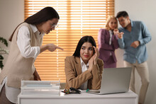 Woman Scolding Employee At Workplace In Office