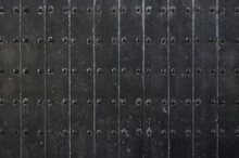 Texture Of Old Black Iron Plate Door. Old Castle Gate Background