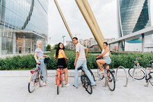Group Multiethnic Friends Posing Outdoor Riding Bicycle Enjoying Sustainable Alternative Transportation