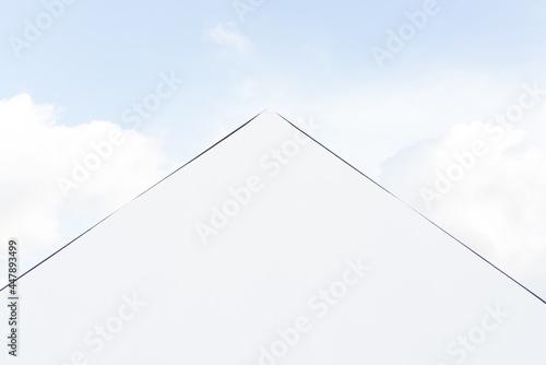 Fototapeta Louvre in Paris in the clouds