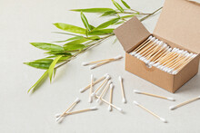 Bamboo Cotton Buds In Carton Box And Bamboo Branch. Ethical, Sustainable No Plastic Lifestyle