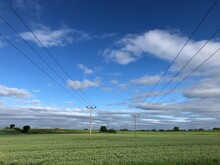 Power Lines Across Farmland In North Yorkshire, England, United Kingdom
