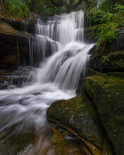 Rocks In The Forest With A Waterfall