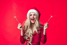 Woman In Christmas Clothes Sparklers Emotions Fashion Red Background