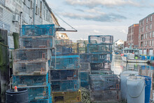 Colorful Lobster Cages In A Busy Harbor In Maine