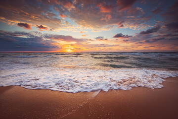 Beautiful sunrise over the sea and tropical beach, paradise island and waves