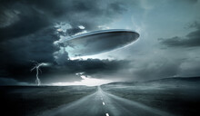 A Large Alien Spaceship Emerging From Storm Clouds On Earth. 3D Illustration.