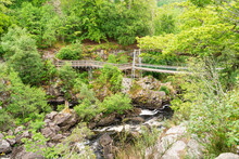 A View Of The Suspension Bridge Over The Black River At The Rogie Falls, Ross-Shire, Scotland; UK
