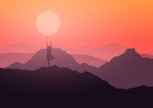 Female In A Yoga Pose In A Sunset Mountain Landscape