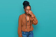 Young African American Woman Wearing Casual Clothes Tired Rubbing Nose And Eyes Feeling Fatigue And Headache. Stress And Frustration Concept.